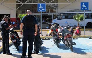 Cozumel Cops ticketing motos
