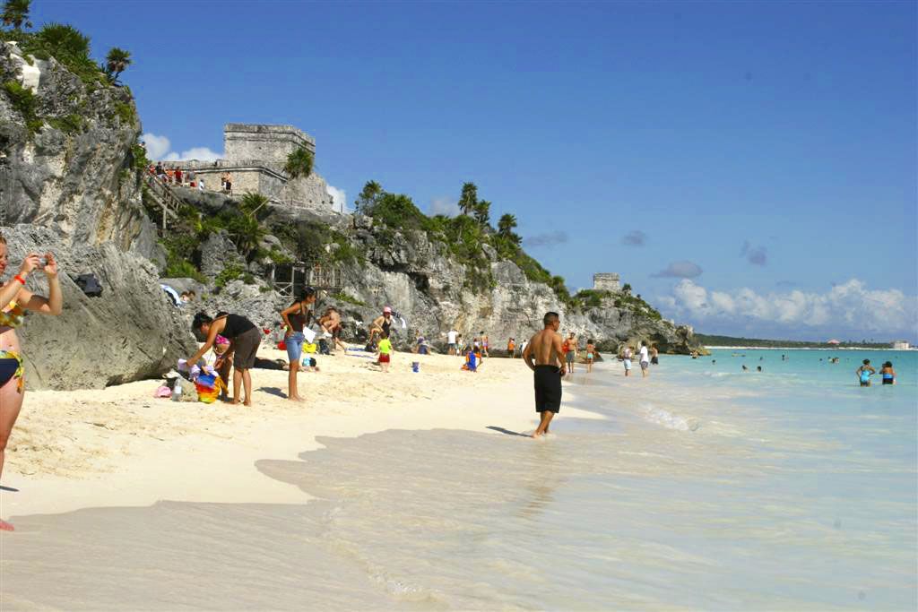 Ruins sit above the beach at Tulum